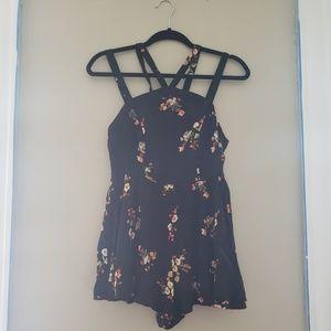 Black strappy floral romper